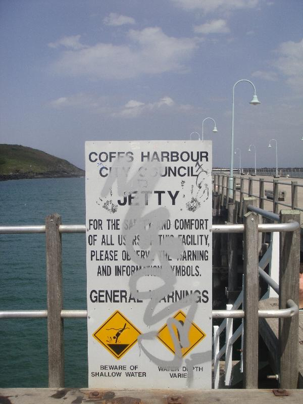 Warning signs on the Coffs Harbour jetty, Australia