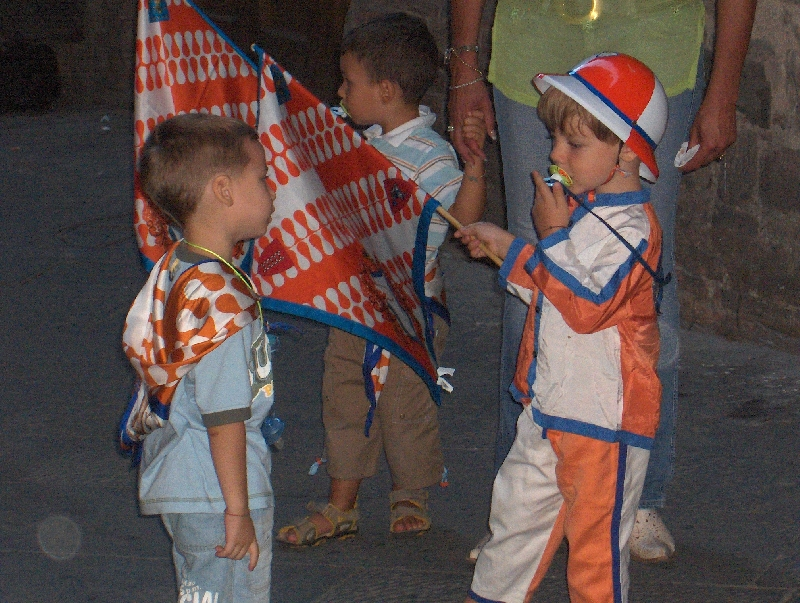 Kids in Siena celebrate Palio victory, Italy