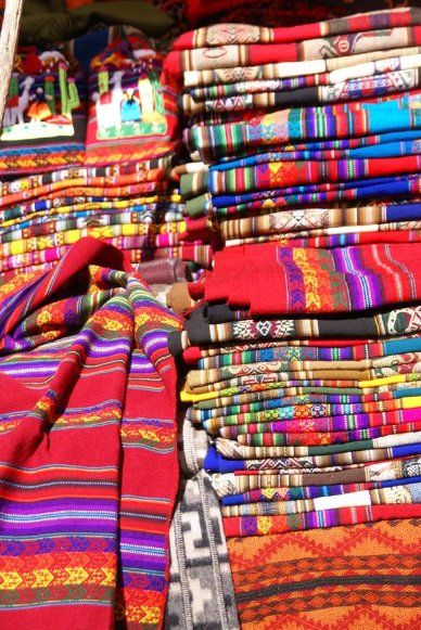 Fabrics at the market in Pisac, Cuzco Peru