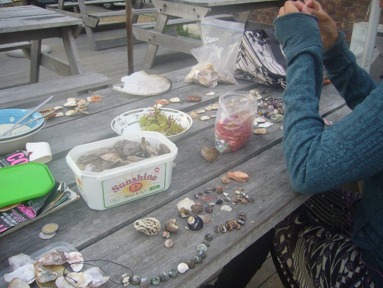 Making jewellery from sea shells, South Africa