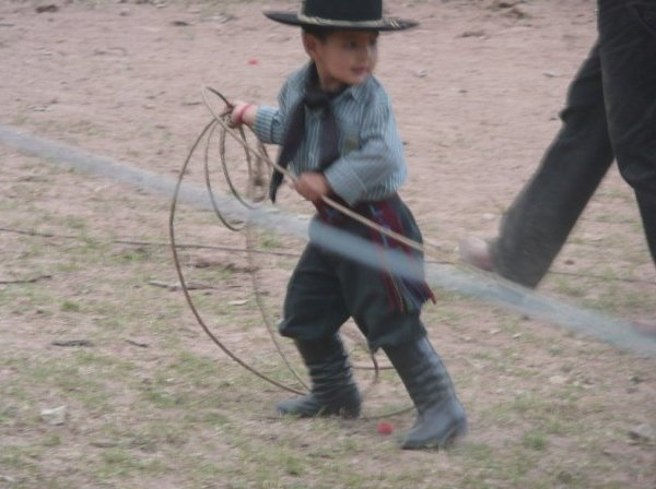 Little gaucho showing his hunting skills, Argentina
