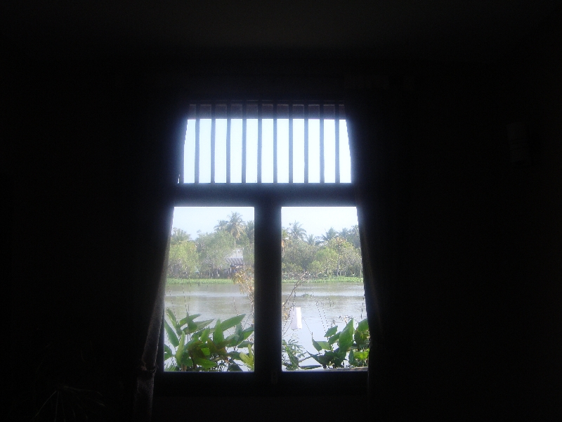 Hotel window looking out on the rive, Thailand