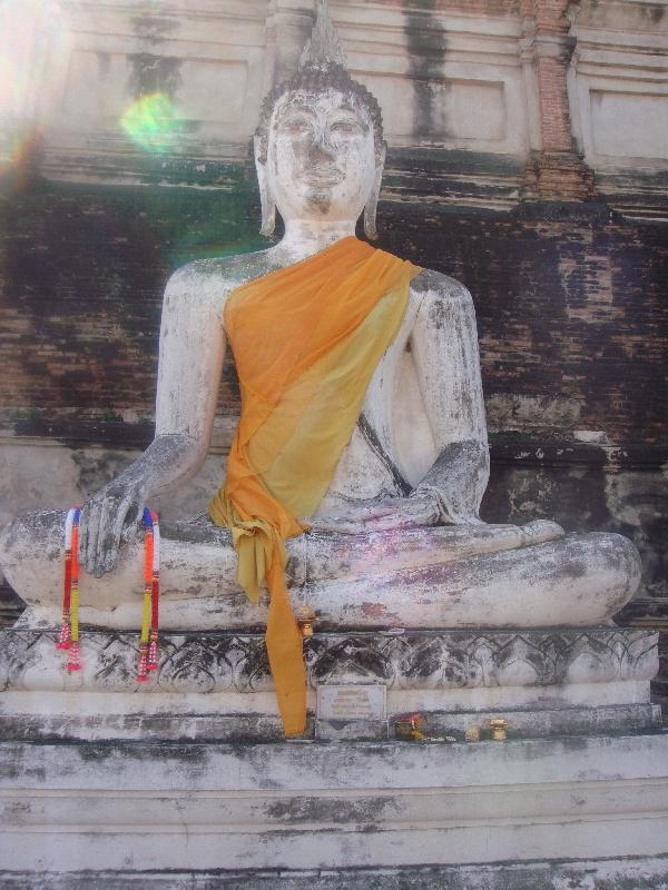 White Buddha statue in golden sarong, Thailand