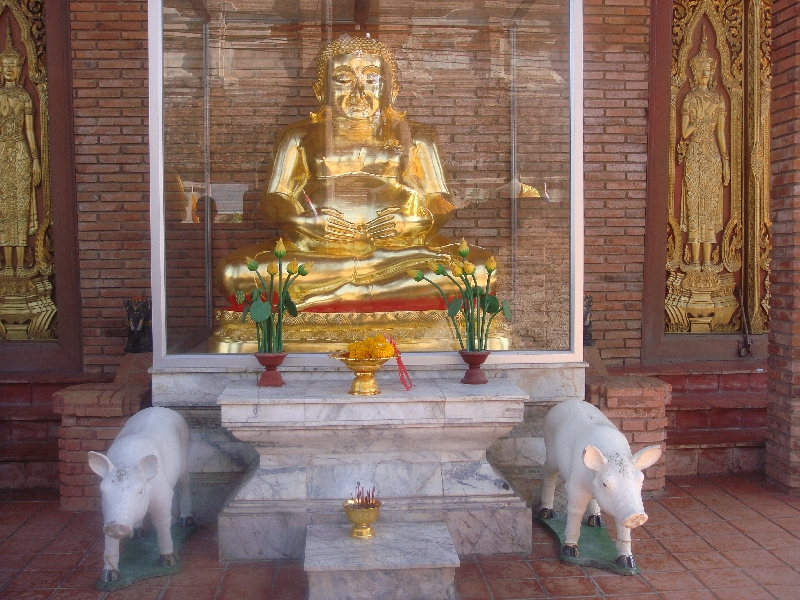 Buddhist altar with golden statue, Thailand