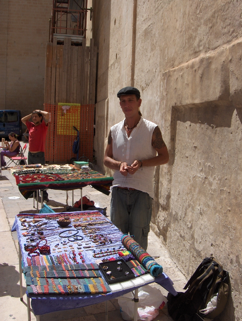 Street vendor selling hand made item, Lecce Italy