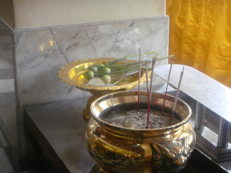 Incense and flower offerings, Nakhon Pathom Thailand