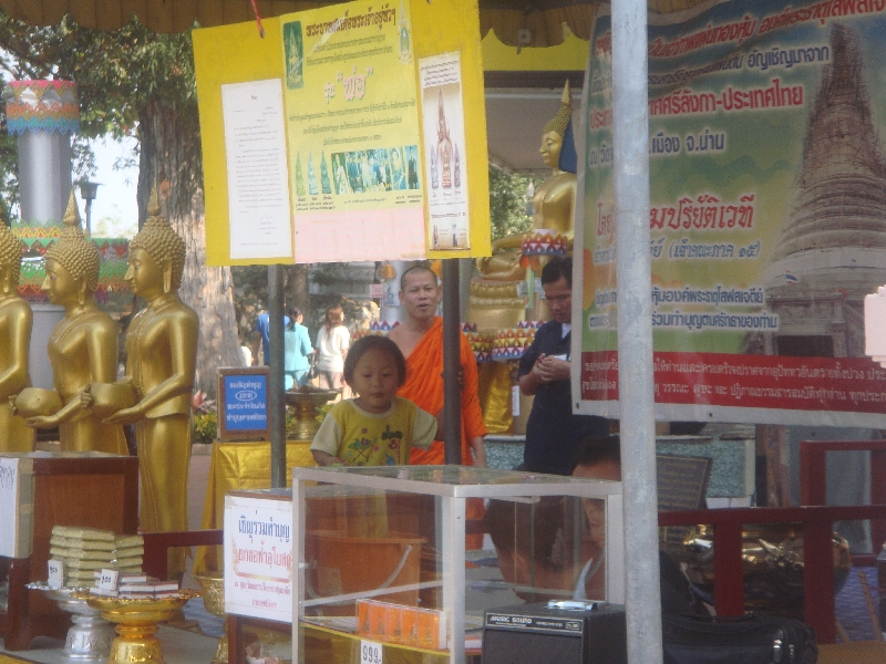 Chedi stand selling flowers and incense, Thailand