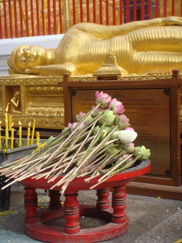 Flowers in front of the reclining Buddha, Thailand