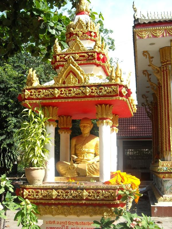 Altar with golden Buddha, Laos