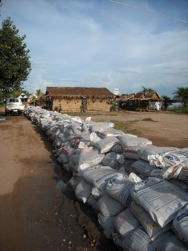Lao build dike in Vientiane, Laos