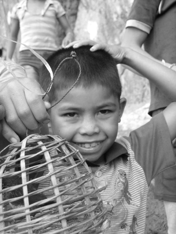Leo boy selling caged birds, Laos