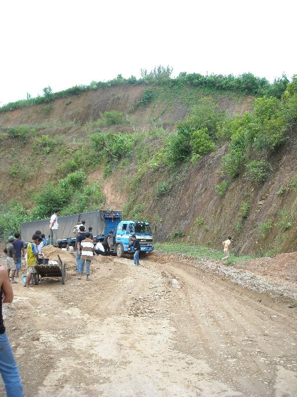 Truck getting stuck in the mud, Laos