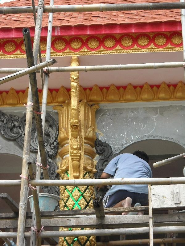 Temple under construction, Laos