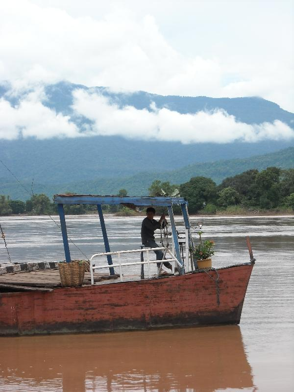 Cambodian ferry in the river, Cambodia