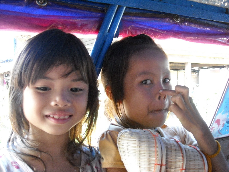 Two Cambodian girls in a tuk tuk, Cambodia