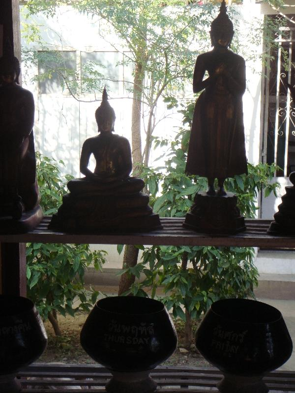Statues above offer bowls, Thailand