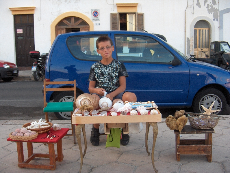 Local boy selling sea shells, Italy