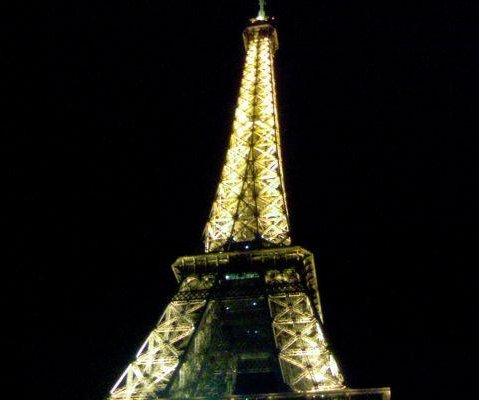Photo of the Eiffel Tower at night., France