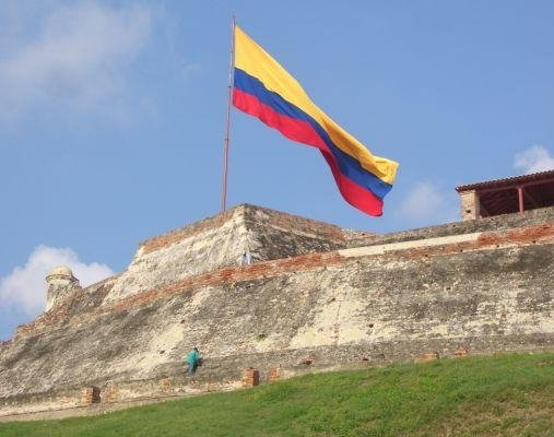 Cartagena Colombia Fortaleza San Felipe de Barajas and the Colombian flag in Cartagena.