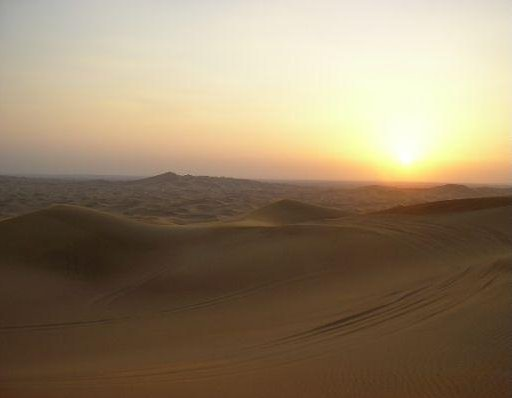 Dubai United Arab Emirates Looking out over the desert at sunset.