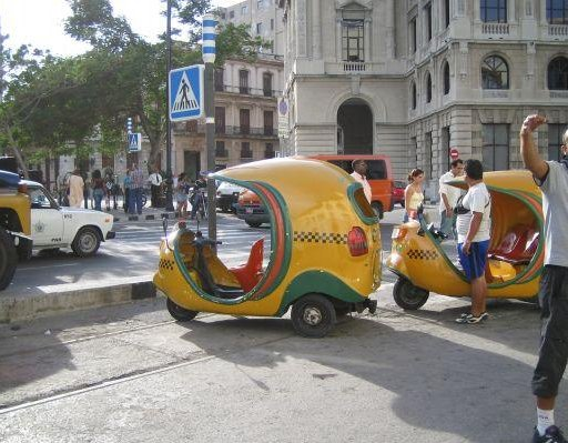 The typical Cuban coco taxi., Cuba
