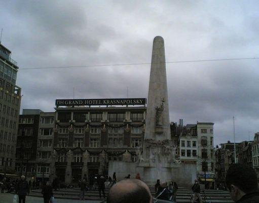 Amsterdam Netherlands Statue memorial The Unity on Dam Square in Amsterdam.