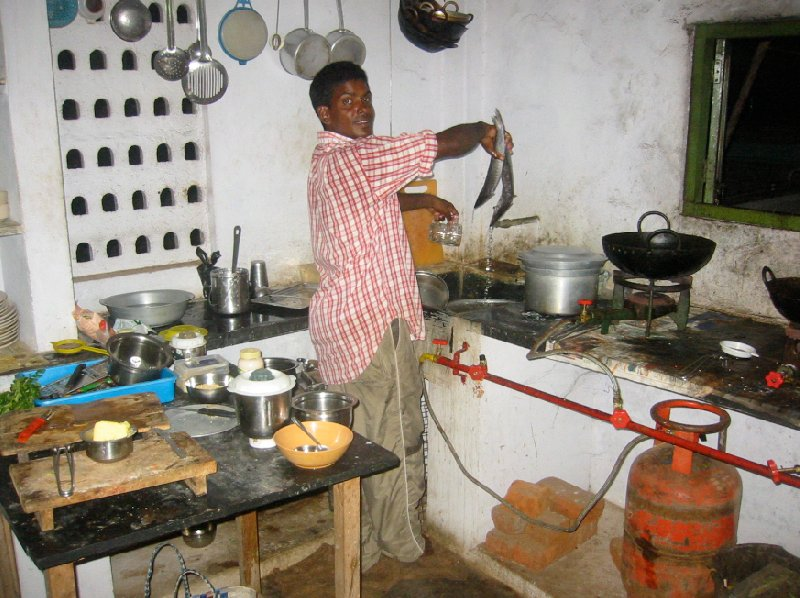 Photo of the houseboat kitchen and our cook., India
