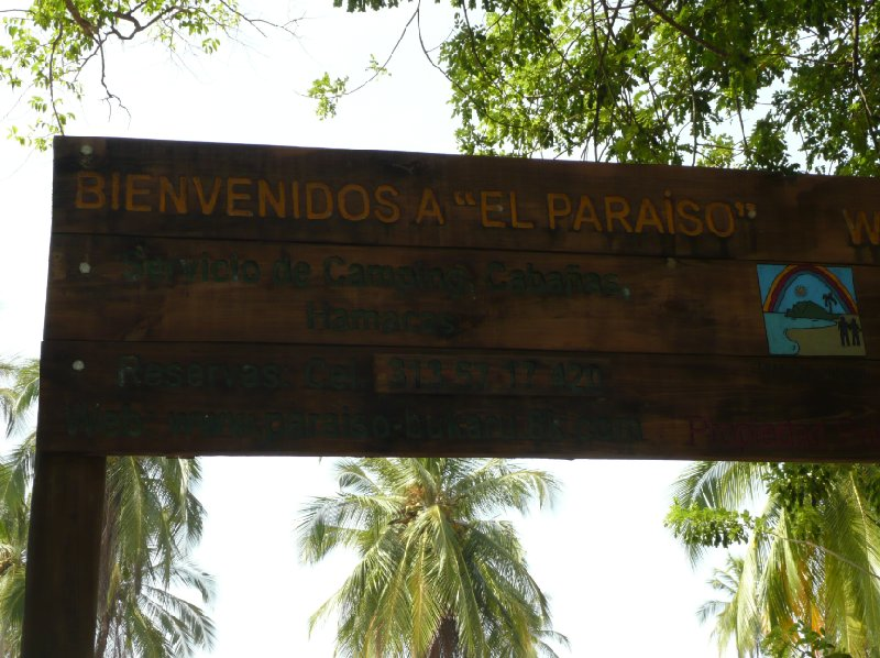 Welcome sign of Camping El Paraiso near Santa Marta with telephone number, Colombia., Colombia