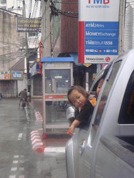 Chiang Mai Thailand Thai Children in the rain in Chiang Mai