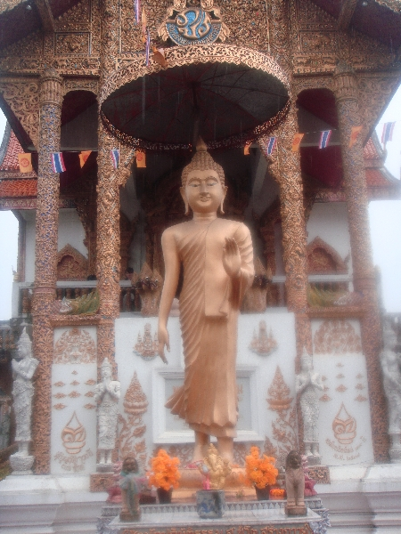 Buddha Statue in front of Wat Bupparam, Chiang Mai, Thailand