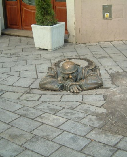 The Cumil The Peeper sculpture in Bratislava, Slowakia, Bratislava Slovakia