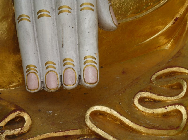 The painted nails of the Buddha of Yangon, Myanmar