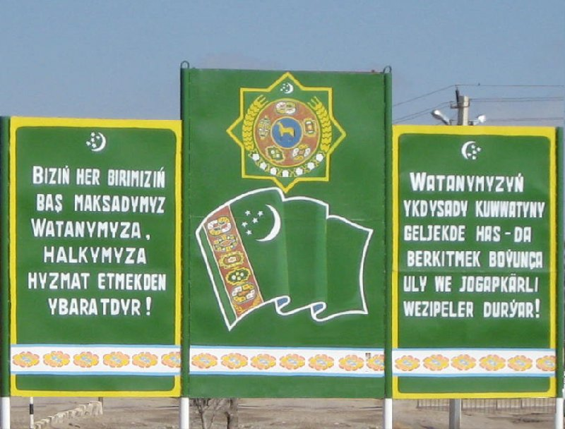 Road sign of the Turkmenistan-Iran border, Turkmenistan