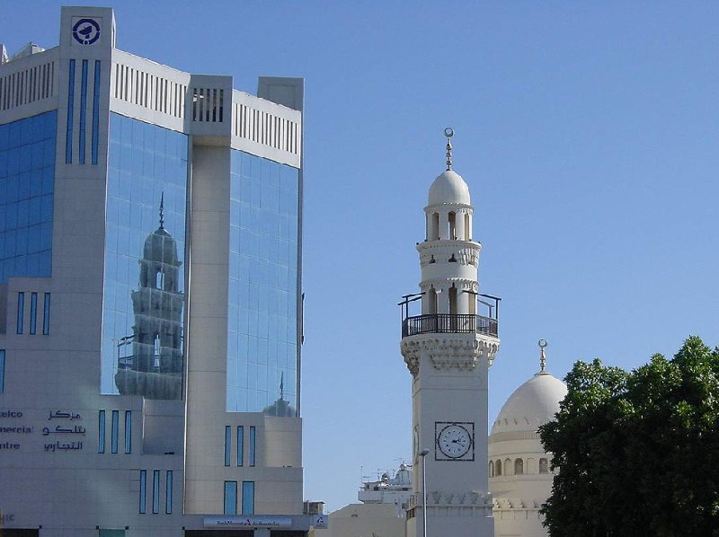 Photo of the NBB Tower and the Yateem Mosque in Manama, Bahrain