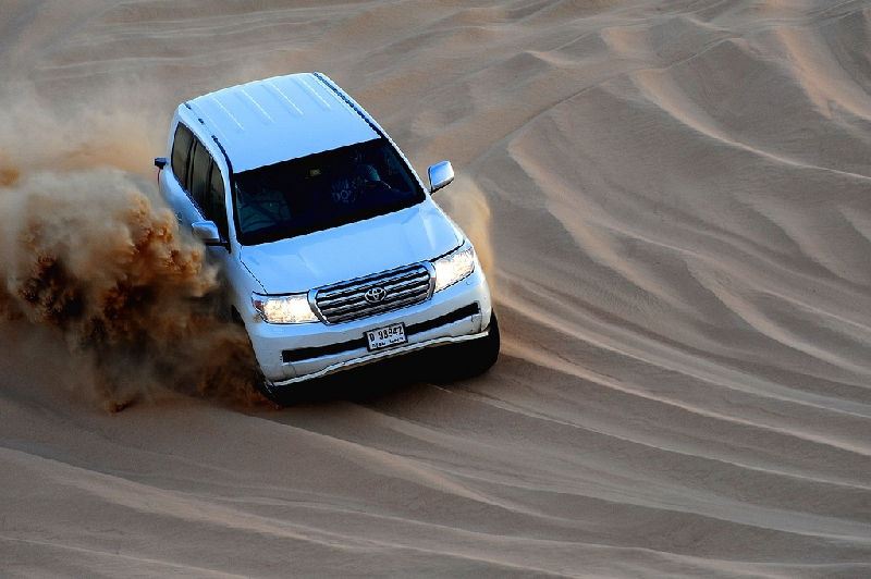 dune basing with other SUV in desert, United Arab Emirates