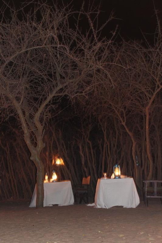 Beautiful dinner setting around the fireplace, Manyara Tanzania