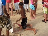 Boys catching a shark at Santa Maria Pier Cape Verde Diary Picture