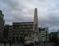 Statue memorial The Unity on Dam Square in Amsterdam.