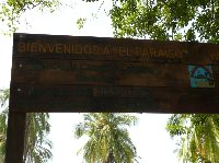 Welcome sign of Camping El Paraiso near Santa Marta with telephone number, Colombia.