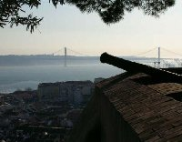 Old canon in Lisbon with a view of the Lisbon Bridge