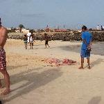 Boys catching a shark at Santa Maria Pier Cape Verde Diary Photography