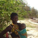 Kenyan woman with her child, Malindi Kenya