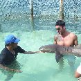 Playa del Carmen Mexico Holding a shark on the Catamaran Tour in Mexico.