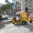 The typical Cuban coco taxi.