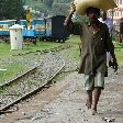 Locals in India walking barefooted at the train station., Kochi India