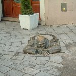The Cumil The Peeper sculpture in Bratislava, Slowakia